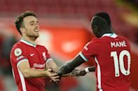 Liverpool forward Diogo Jota (left) celebrates his winner against Sheffield United