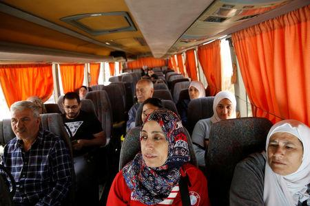 Jordanian tourists sit in the bus as they wait to travel to Syria at Jordan's Jaber border crossing, near Syria's Nassib checkpoint, near Mafraq, Jordan, October 25, 2018. Picture taken October 25, 2018. REUTERS/Muhammad Hamed