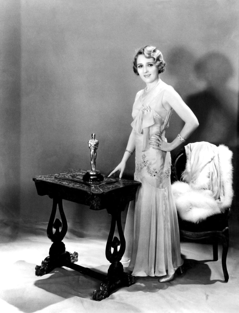 "<p>The film star (who was nicknamed ""America's Sweetheart"") dazzled in a mermaid gown with bow details and sparkly bracelets. She won the Oscar for her leading role in <em>Coquette</em>.</p>"