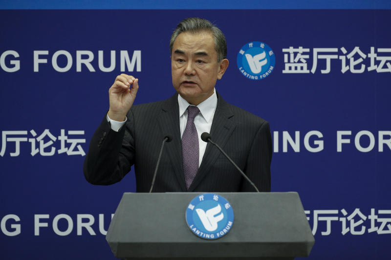 Chinese Foreign Minister Wang Yi gestures as he speaks during the Lanting Forum on the International Order and Global Governance in the Post COVID-19 Era held at the Ministry of Foreign Affairs office in Beijing, Monday, Sept. 28, 2020. Even though the spread of COVID-19 has been all but eradicated in China, the pandemic is still surging across the globe with ever rising death toll. (AP Photo/Andy Wong)