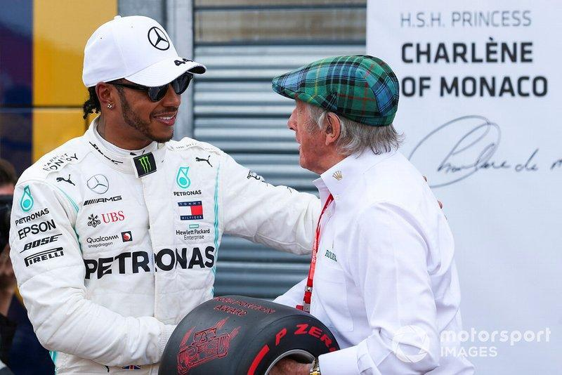 """Lewis Hamilton, Mercedes AMG F1, celebrates pole position, and is presented with the Pirelli Pole Trophy by Jackie Stewart<span class=""""copyright"""">Dom Romney / LAT Images</span>"""