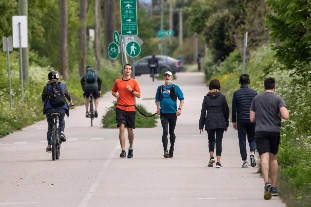 Field and O'Shea run along Vancouver's Arbutus Greenway. People yell at them occassionally because they are not six feet apart.