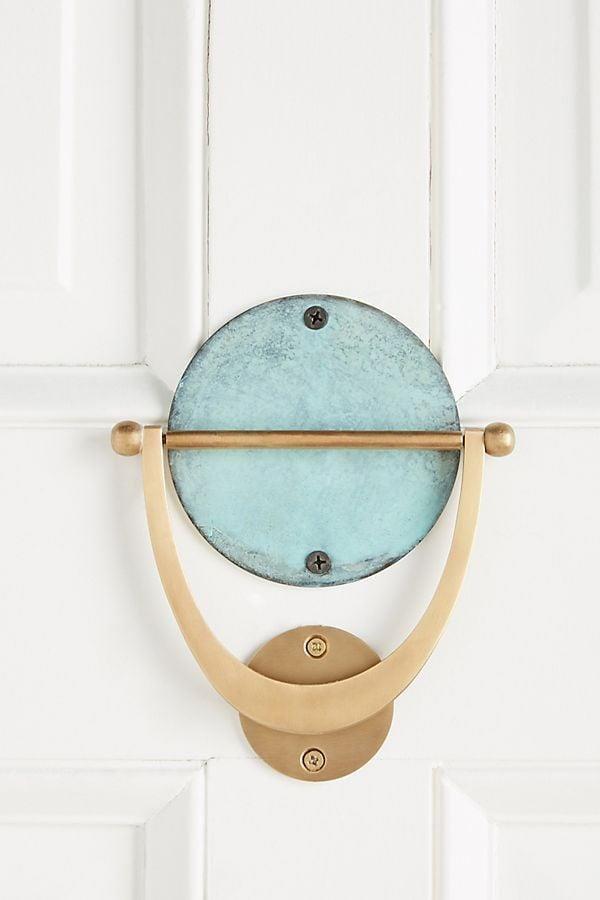"""<p>Knock knock! The <a href=""""https://www.popsugar.com/buy/Isoke-Door-Knocker-538764?p_name=Isoke%20Door%20Knocker&retailer=anthropologie.com&pid=538764&price=58&evar1=casa%3Aus&evar9=28990454&evar98=https%3A%2F%2Fwww.popsugar.com%2Fphoto-gallery%2F28990454%2Fimage%2F45955405%2FFront-Door-Try-Out-New-Knocker&list1=shopping%2Caffordable%20decor%2Chome%20shopping%2Cunder%20%24100&prop13=api&pdata=1"""" rel=""""nofollow"""" data-shoppable-link=""""1"""" target=""""_blank"""" class=""""ga-track"""" data-ga-category=""""Related"""" data-ga-label=""""http://www.anthropologie.com/shop/isoke-door-knocker?category=SEARCHRESULTS&amp;color=027"""" data-ga-action=""""In-Line Links"""">Isoke Door Knocker</a> ($58) is here to give your door some serious upgrading.</p>"""