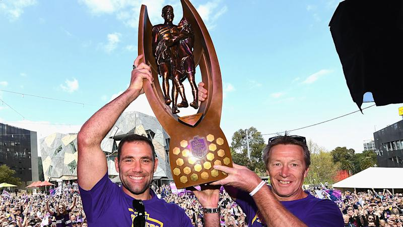Pictured here, Storm captain Cameron Smith and coach Craig Bellamy with the NRL trophy.