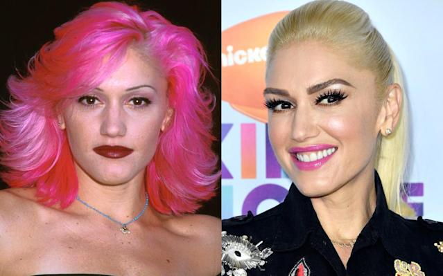 <p>One thing is for sure: Gwen Stefani loves the color pink. But she also hasn't been afraid to switch things up over the years and go for a pop of pink lipstick rather than a full head of the hue. (Photo: Getty Images) </p>
