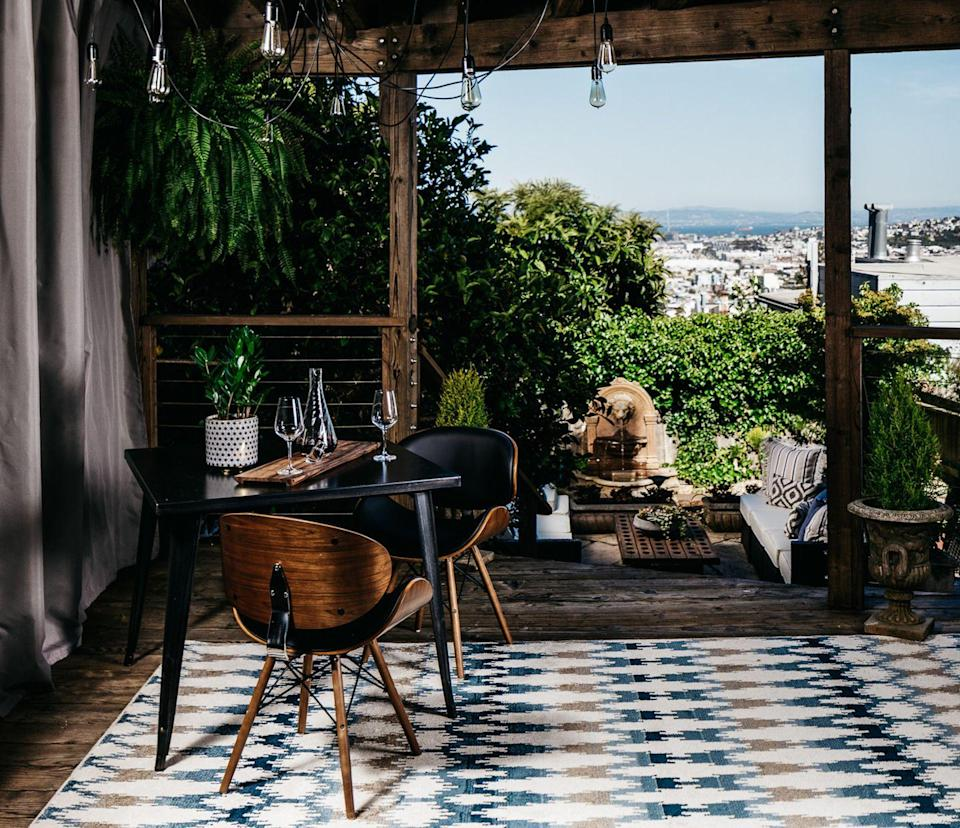 "<p>A covered terrace in San Francisco takes inspiration from the iconic style, with mid-century modern chairs and a summery, patterned rug.</p><p><em>Design by <a href=""https://deringhall.com/interior-designers/deniece-duscheone-inc"" rel=""nofollow noopener"" target=""_blank"" data-ylk=""slk:Deniece Duscheone Inc."" class=""link rapid-noclick-resp"">Deniece Duscheone Inc.</a></em></p>"