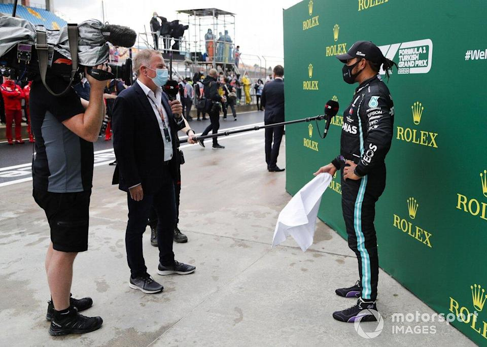 "Martin Brundle, Sky TV, interviews Lewis Hamilton, Mercedes-AMG F1, after winning the race, to take his 7th World Championship title<span class=""copyright"">Steven Tee / Motorsport Images</span>"