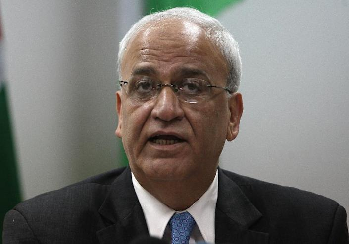 Saeb Erekat, Palestinian chief negotiator, speaks to journalists during a press conference in the West Bank city of Ramallah on January 2, 2012 (AFP Photo/Abbas Momani)