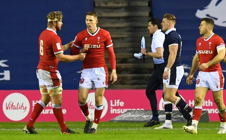 Wales wing Louis Rees-Zammit (second left) celebrates scoring a try against Scotland in the 2021 Six Nations