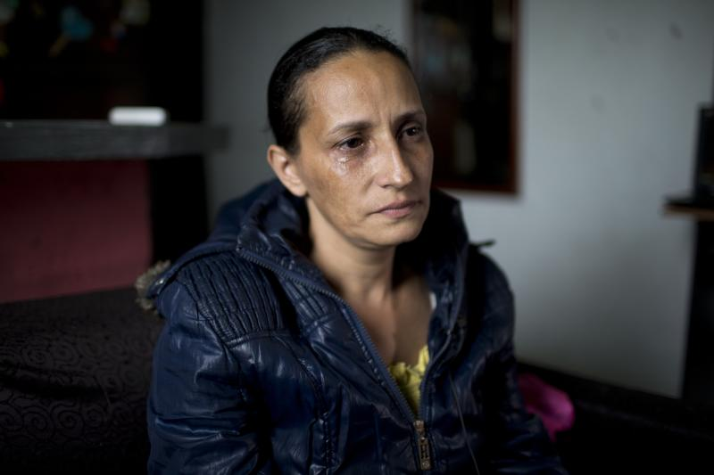 Judith Perez, mother of Karen Palacios, cries during an interview at her house in Los Teques in the outskirts of Caracas, Venezuela, Tuesday, July 16, 2019. Karen Palacios who plays the clarinet and was cut from the National Philharmonic for criticizing the government, and who was detained for 6 weeks, was released today. (AP Photo/Ariana Cubillos)