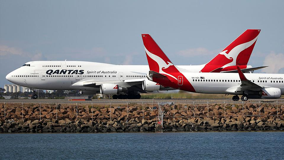 Picture of two Qantas planes. Airlines have limited flights amid the coronavirus outbreak
