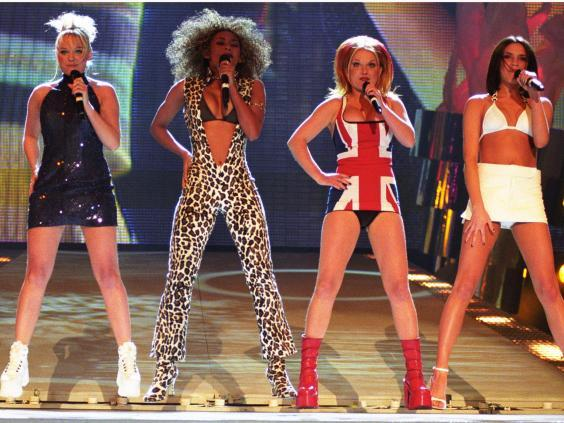 Four of the five Spice Girls, the girl band Geri Horner (pictured in the Union Jack dress) left in 1998 (Rex)