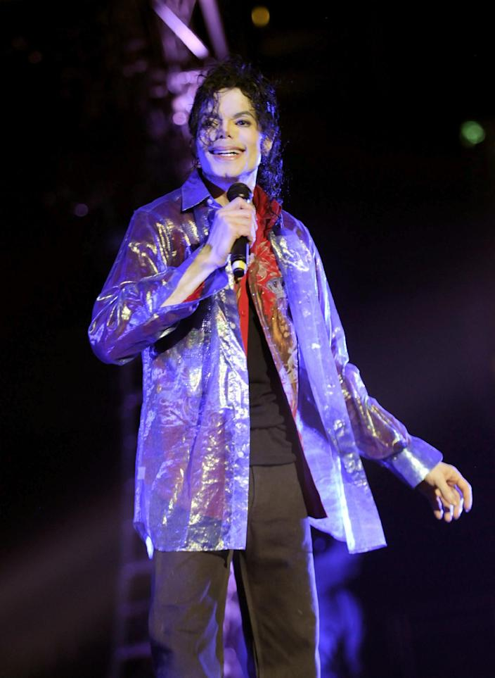"""FILE - In this June 23, 2009 handout photo provided by AEG, pop star Michael Jackson rehearses at the Staples Center in Los Angeles. An AEG Live accounting executive testified Monday, May 20, 2013, in a Los Angeles courtroom that the company spent $24 million on preparations for Jackson's ill-fated """"This Is It"""" shows, however never paid the singer's personal doctor convicted of involuntary manslaughter because a fully-signed agreement was never obtained. (AP Photo/ Kevin Mazur, AEG/Getty Images, File) ** NO SALES, ARCHIVE OUT. MANDATORY CREDIT **"""