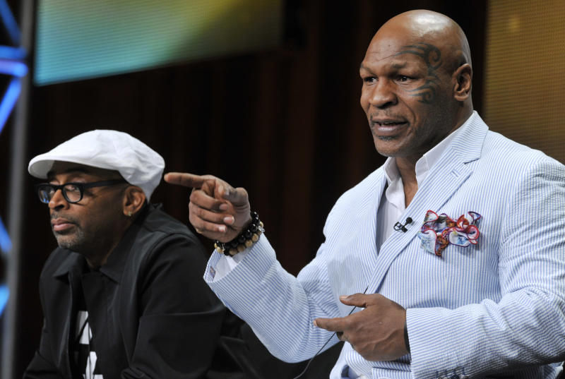 """Spike Lee, left, director of """"Mike Tyson: Undisputed Truth,"""" and Mike Tyson take part in a panel discussion on the film during HBO's Summer 2013 TCA panel at the Beverly Hilton Hotel on Thursday, July 25, 2013, in Beverly Hills, Calif. (Photo by Chris Pizzello/Invision/AP)"""