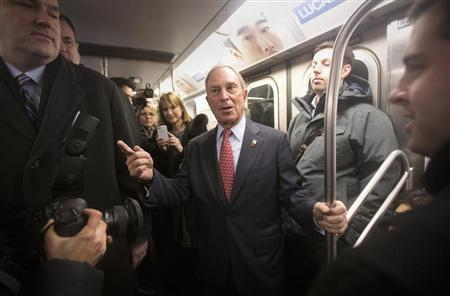 Outgoing mayor Michael Bloomberg rides the subway after he left City Hall for last time as Mayor of New York, on New Year's Eve in New York