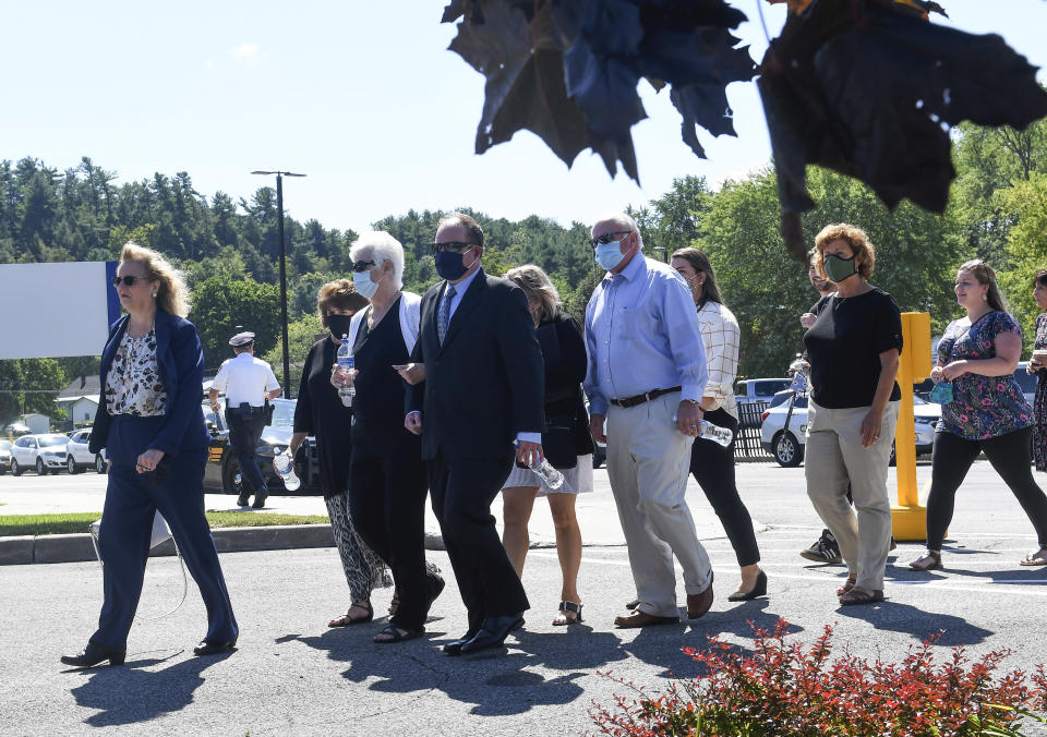 Family and friends of those killed in the 2018, limousine crash what for the trail of Nauman Hussain, to start in a converted courtroom to accommodate more people at the Schoharie High School gymnasium Thursday, Sept. 2, 2021, in Schoharie, N.Y. (AP Photo/Hans Pennink)