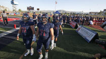 Herriman players take the field for a high school football game against Davis on Thursday, Aug. 13, 2020, in Herriman, Utah. Utah is among the states going forward with high school football this fall despite concerns about the ongoing COVID-19 pandemic that led other states and many college football conferences to postpone games in hopes of instead playing in the spring. (AP Photo/Rick Bowmer)