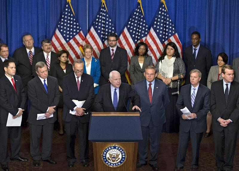 "Sen. John McCain, R-Ariz., center, speaks as immigration reform legislation as outlined by the Senate's bipartisan ""Gang of Eight"" that would create a path for the nation's 11 million unauthorized immigrants to apply for U.S. citizenship, Thursday, April 18, 2013, on Capitol Hill in Washington. From left are, Sen. Marco Rubio, R-Fla., Senate Majority Whip Richard Durbin of Ill., Sen. Charles Schumer, D-N.Y., Sen. John McCain, R-Ariz., Sen. Robert Menendez, D-N.J., Sen. Lindsey Graham, R-S.C., and Sen. Michael Bennet, D-Colo. (AP Photo/J. Scott Applewhite)"