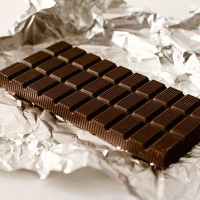"""<p>Bad news for chocolate lovers: Chocolate seems to cause more reflux than any other food. It's a triple whammy:</p> <ol><li>Chocolate contains caffeine and other stimulants such as theobromine, which cause reflux.</li> <li>Chocolate is high in fat, and fat causes reflux.</li> <li>Chocolate is also high in cocoa, and cocoa causes reflux.</li> </ol><p>Theoretically, dark chocolate isn't as bad as high-fat milk chocolate, but let's face it—all chocolate is bad for reflux.</p> <p><b>RELATED: </b><a href=""""https://www.health.com/health/gallery/0,,20527766,00.html""""><b>12 Ways to Soothe Heartburn in Pregnancy</b></a></p>"""