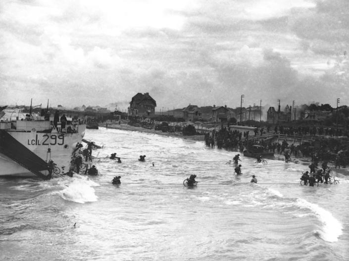 Soldiers of the 2nd Canadian Flotilla are carrying bicycles as they disembark from their Landing Craft Infantries at a beachhead code-named Juno Beach at Bernières-sur-Mer during the Allied invasion of Normandy, France, on June 6, 1944. (Photo: AP)