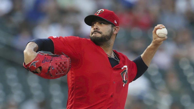 FIEL - In this Sept. 17, 2019, file photo, Minnesota Twins pitcher Martin Pérez throws against the Chicago White Sox in the first inning of a baseball game in Minneapolis. People familiar with the negotiations tell The Associated Press on Friday, Dec. 13, 2019, that the Boston Red Sox have agreed to one-year contracts with free agent left-hander Martin Pérez and shortstop José Peraza. The people spoke on the condition of anonymity because the deals had not yet been announced. (AP Photo/Jim Mone, File)