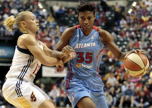 Atlanta Dream guard Angel McCoughtry, right, dribbles around Indiana Fever guard Erin Phillips during the first half of a WNBA basketball first-round playoff game in Indianapolis, Tuesday, Oct. 2, 2012. (AP Photo/AJ Mast)