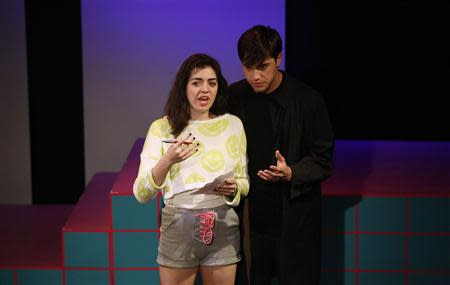 "Cast members Barrett Wilbert Weed and Ryan McCartan perform during the rehearsals for ""Heathers the Musical"" at the Hudson theatre in Los Angeles, California September 17, 2013. REUTERS/Mario Anzuoni"