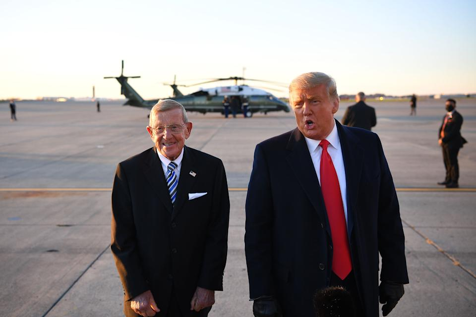 US President Donald Trump speaks with the press alongside former American football player and coach Lou Holtz upon arrival at Pittsburgh International Airport in Pittsburgh, Pennsylvania on October 31, 2020. (Photo by MANDEL NGAN / AFP) (Photo by MANDEL NGAN/AFP via Getty Images)