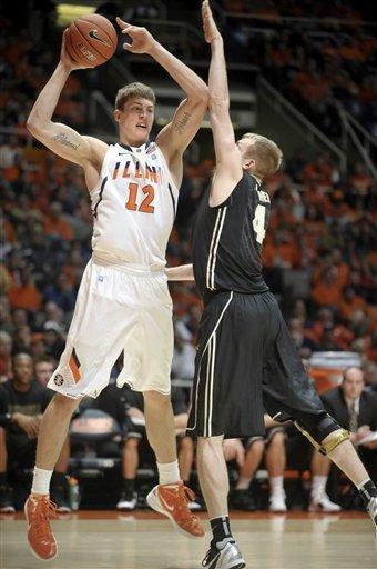 Illinois center Meyers Leonard (12) is defended by Purdue forward Robbie Hummel (4) in the first half of an NCAA college basketball game at Assembly Hall in Champaign, Ill., on Wednesday, Feb. 15, 2012. (AP Photo/Heather Coit)