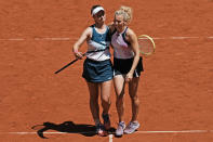 Czech Republic's Barbora Krejcikova, left, and compatriot Katerina Siniakova walk together after defeating USA's Bethanie Mattek-Sands and Poland's Iga Swiatek during their women's doubles final match of the French Open tennis tournament at the Roland Garros stadium Sunday, June 13, 2021 in Paris. (AP Photo/Thibault Camus)