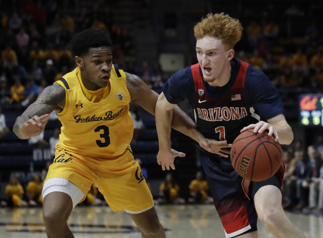 Arizona's Nico Mannion, right, drives the ball against California's Paris Austin (3) in the first half of an NCAA college basketball game Thursday, Feb. 13, 2020, in Berkeley, Calif. (AP Photo/Ben Margot)
