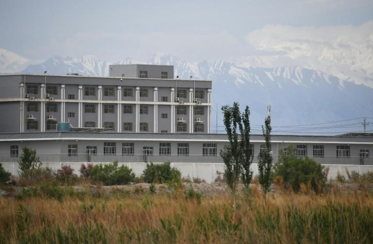 Re-education camp detainees have reportedly been used as forced labour at Chinese factories (AFP Photo/GREG BAKER)