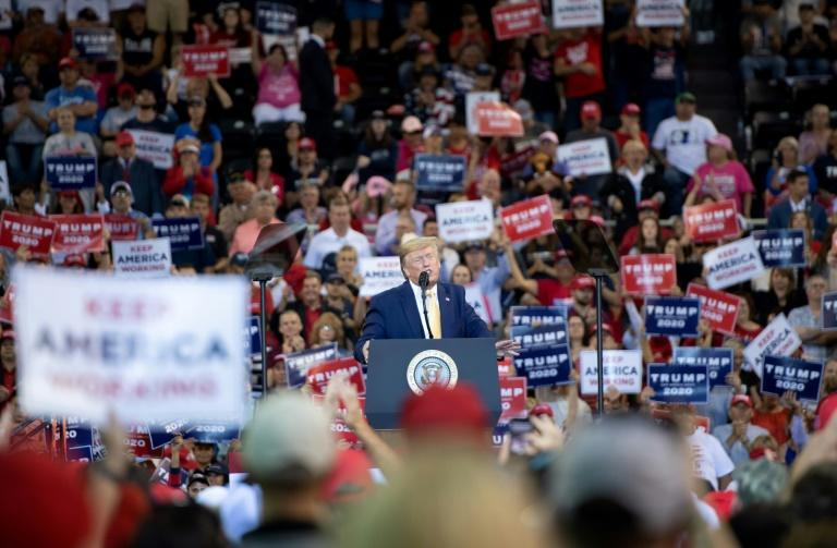 At rallies, the US president regularly encourages the crowd to boo and heckle journalists covering the event (AFP Photo/SAUL LOEB)
