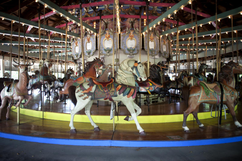 This June 19, 2013 photo provided by the NYC Landmarks Preservation Commission shows the 1910 Forest Park Carousel in the Queens borough of New York. The carousel, featuring 46 hand-carved horses, a lion, tiger and deer, is the city's first carousel to get the designation from Landmarks Preservation Commission. (AP Photo/NYC Landmarks Preservation Commission, Christopher D. Brazee)