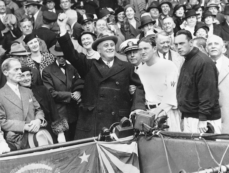 FILE - In this Oct. 5, 1933, file photo, President Franklin D. Roosevelt prepares to throw out the ceremonial first pitch at at Griffith Stadium in Washington, before Game 3 of baseball's World Series between as Washington Senators manager Joe Cronin, third from right, and New York Giants manager Bill Terry, second from right, look on. The President uncorked an almost wild throw that sent the players scrambling. In clinching a playoff spot, the Washington Nationals put the nation's capital in baseball's postseason for the first time in nearly 80 years. (AP Photo/File)
