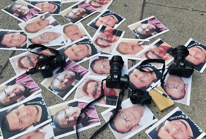 Pictures of journalists murdered in Mexico are displayed during a May 2017 protest in Mexico City (AFP Photo/YURI CORTEZ)
