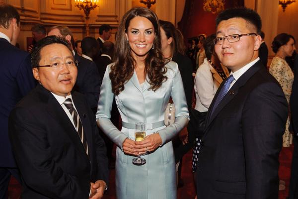 Catherine, Duchess of Cambridge poses with President of Mongolia Elbegdorj Tsakhia (L) during a reception at Buckingham Palace a reception for Heads of State and Government attending the Olympics Opening Ceremony on July 27, 2012 in London, England. (Photo by Dominic Lipinski - WPA Pool/Getty Images)
