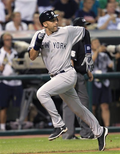 New York Yankees' Derek Jeter heads home to score on a sacrifice fly by Mark Teixeira in the sixth inning of a baseball game against the Cleveland Indians, Saturday, Aug. 25, 2012, in Cleveland. (AP Photo/Tony Dejak)