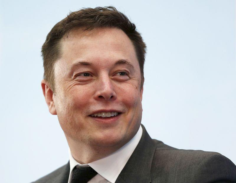 Tesla Chief Executive Elon Musk smiles as he attends a forum on startups in Hong Kong