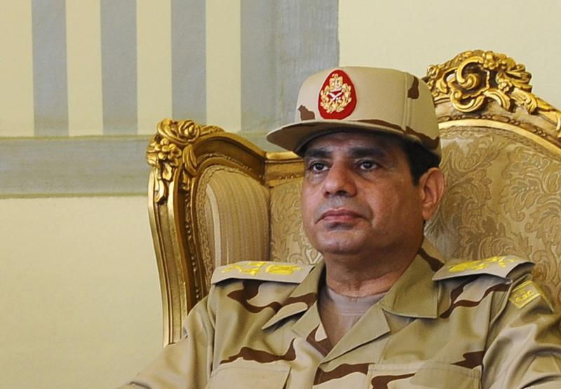 Egypt's Defense Minister Abdel Fattah al-Sisi is seen during a news conference in Cairo on the release of seven members of the Egyptian security forces kidnapped by Islamist militants in Sinai, in this May 22, 2013 file photo. Egyptian army chief General Abdel Fattah al-Sisi has been promoted to the rank of field marshal, the presidency said on January 27, 2014, fuelling speculation he is about to retire from the military and run for president. REUTERS/Stringer (EGYPT - Tags: MILITARY HEADSHOT POLITICS)