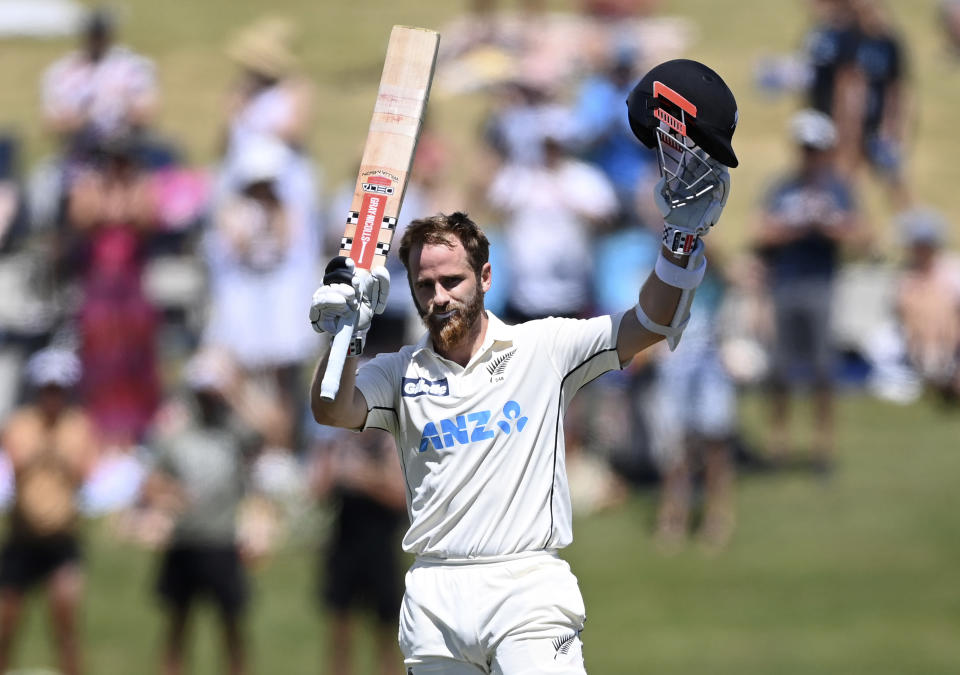 New Zealand cricket captain Kane Williamson celebrates on reaching his century during play on day two of the first cricket test between Pakistan and New Zealand at Bay Oval, Mount Maunganui, New Zealand, Sunday, Dec. 27, 2020. (Andrew Cornaga/Photosport via AP)