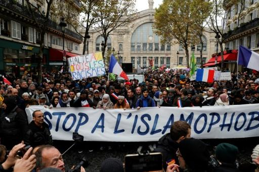The march was called after an elderly far-right activist attacked a mosque in southern France, shooting and injuring two people