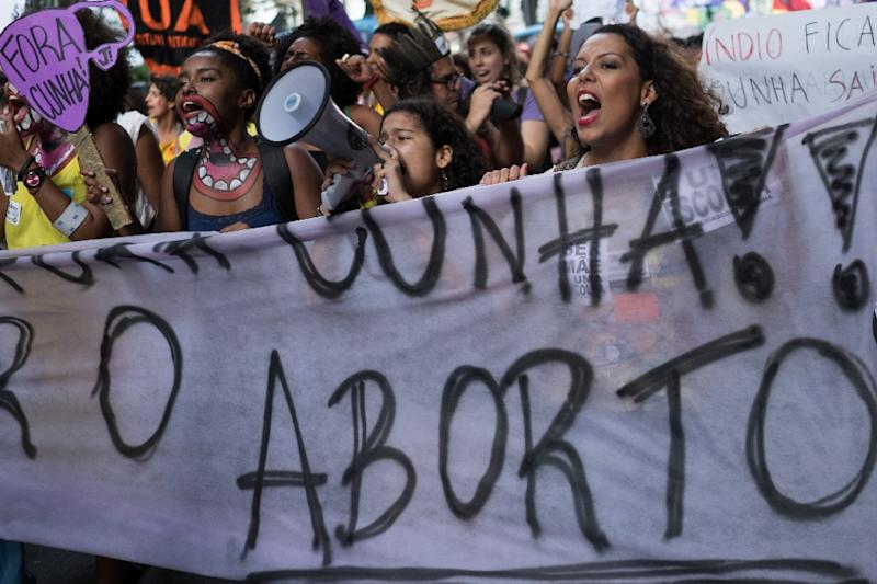 Brazilian women demonstrate in favor of abort legalization and against the president of the Brazilian Chamber of Deputies, Eduardo Cunha, in Rio de Janeiro downtown on November 11, 2015 (AFP Photo/Christophe Simon)