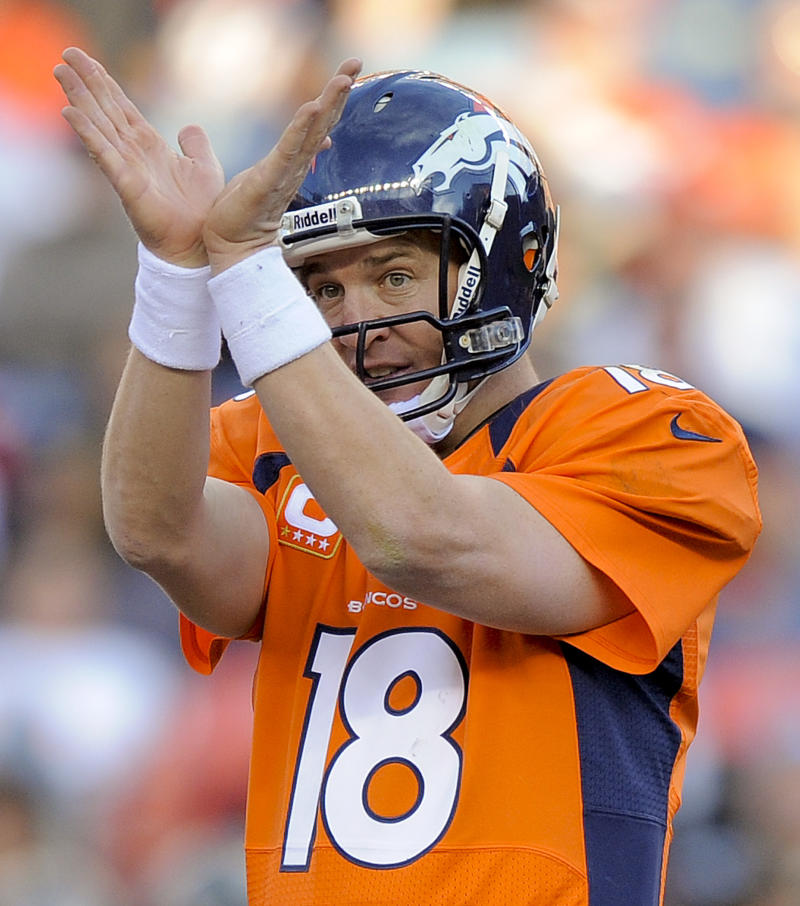 Denver Broncos quarterback Peyton Manning (18) calls an audible at the line of scrimmage against the Tampa Bay Buccaneers in the third quarter of an NFL football game, Sunday, Dec. 2, 2012, in Denver. Manning passed Pro Football Hall of Famer Dan Marino for the second most completions all-time during the game.  (AP Photo/Jack Dempsey)
