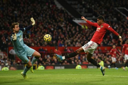 Manchester United forward Marcus Rashford scores the opening goal in the Premier League match against Norwich