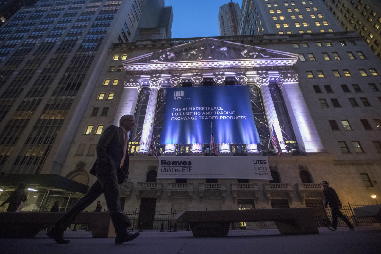 <p> FILE - In this Tuesday, Oct. 25, 2016, file photo, a pedestrian walks past the New York Stock Exchange, in lower Manhattan. Big gains for Facebook, Verizon Communications and other companies reporting healthier-than-expected results nudged U.S. stock indexes a bit further into record territory on Thursday, July 27, 2017 (AP Photo/Mary Altaffer, File)