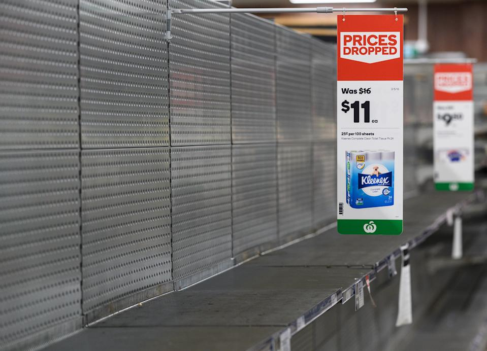 Empty shelves normally stocked with toilet paper rolls at Woolworths Supermarket in Parramatta, Sydney. Source: AAp