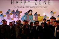 "Policemen stand during the launch of the ""Happy Zone"" program aiming to improve the image of a city in Pattaya, Thailand March 25, 2017. Picture taken March 25, 2017. REUTERS/Jorge Silva"