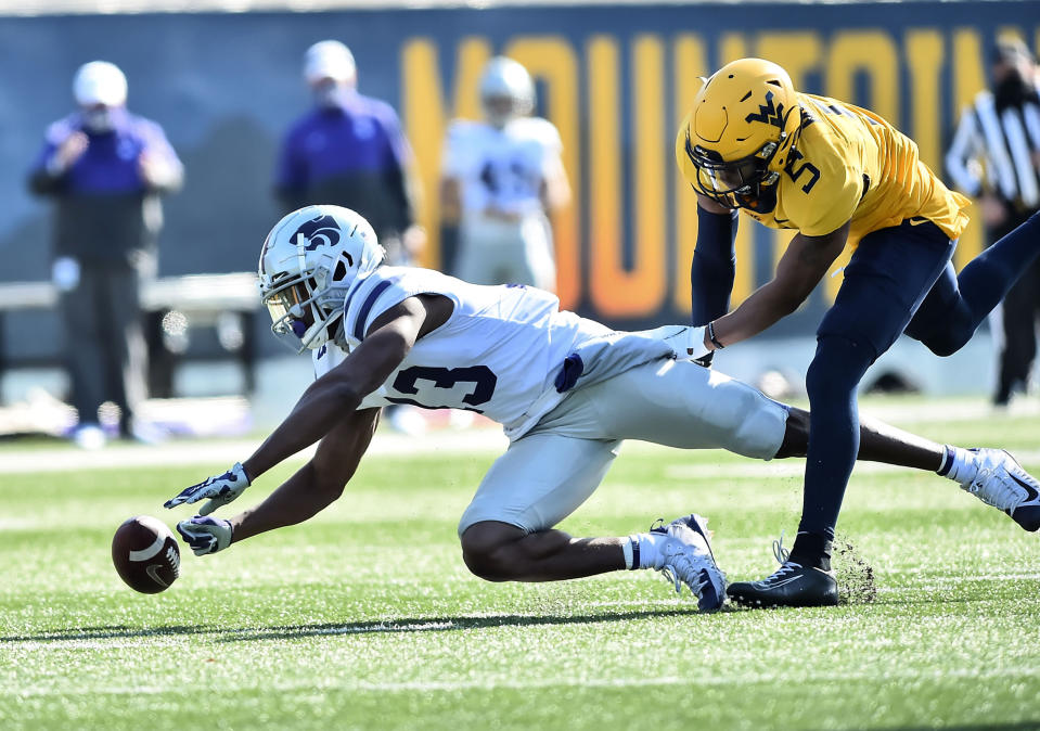 West Virginia cornerback Dreshun Miller (5) breaks up the pass intended for Kansas State wide receiver Chabastin Taylor (13) during an NCAA college football game Saturday, Oct. 31, 2020, in Morgantown, W.Va. (William Wotring/The Dominion-Post via AP)