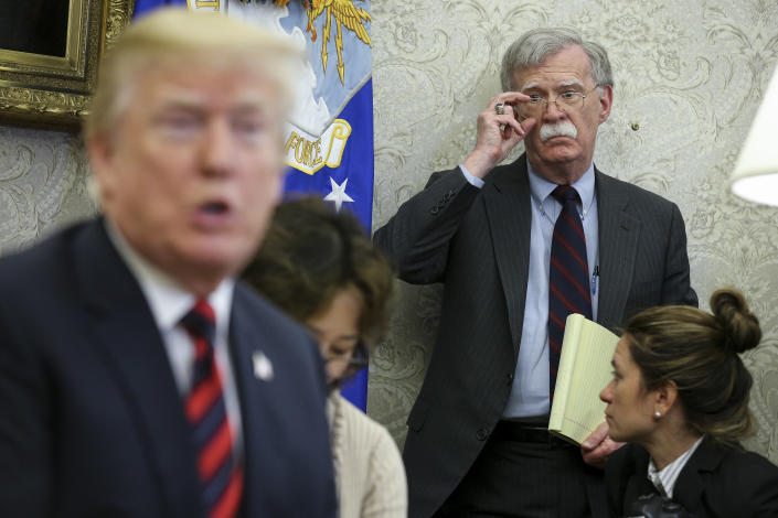 President Trump speaks as national security advisor John Bolton listens during in the Oval Office of the White House, May 22, 2018. (Oliver Contreras-Pool/Getty Images)